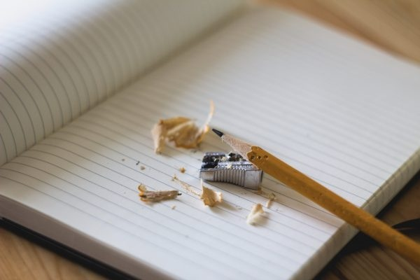Foto: Notizbuch mit Bleistift